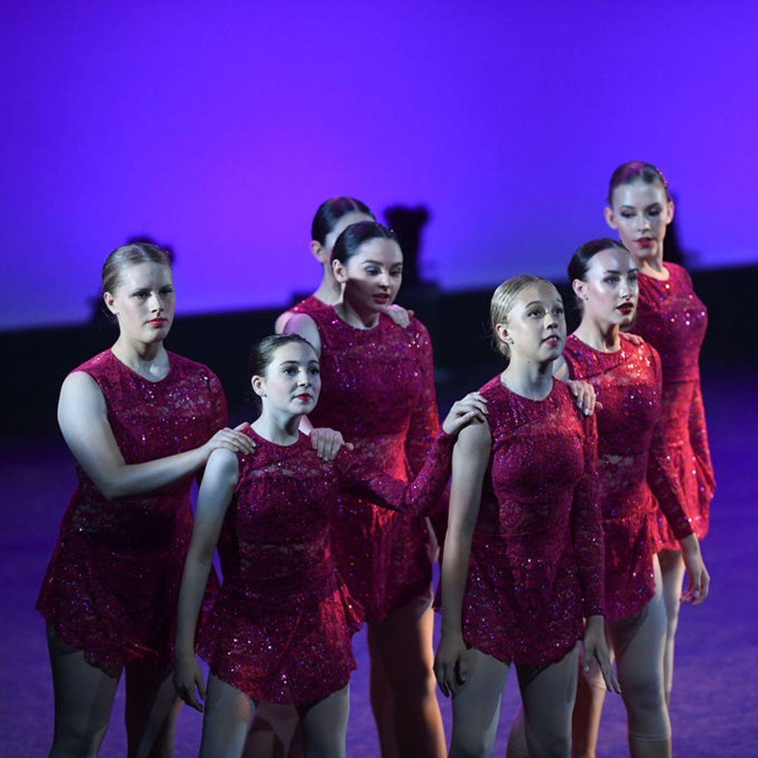 Young Danceworks performers in red costumes