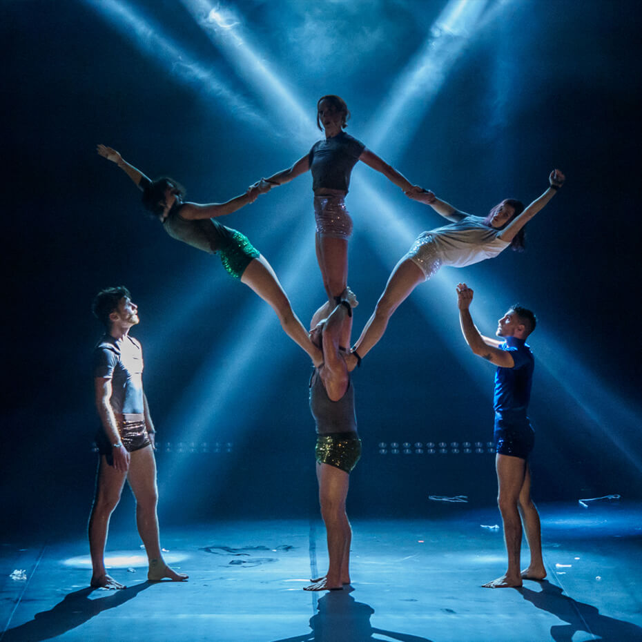 five acrobats on stage