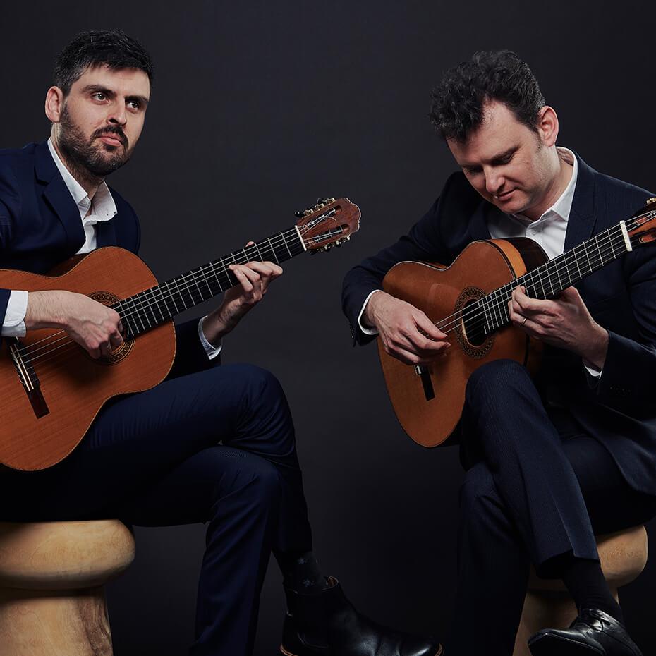 Grigoryan brothers playing guitars