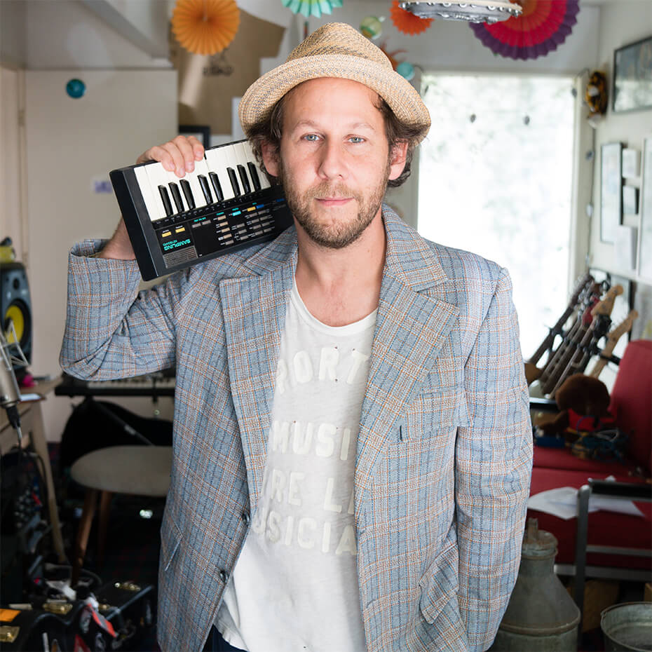 Ben Lee wearing hat and looking at camera