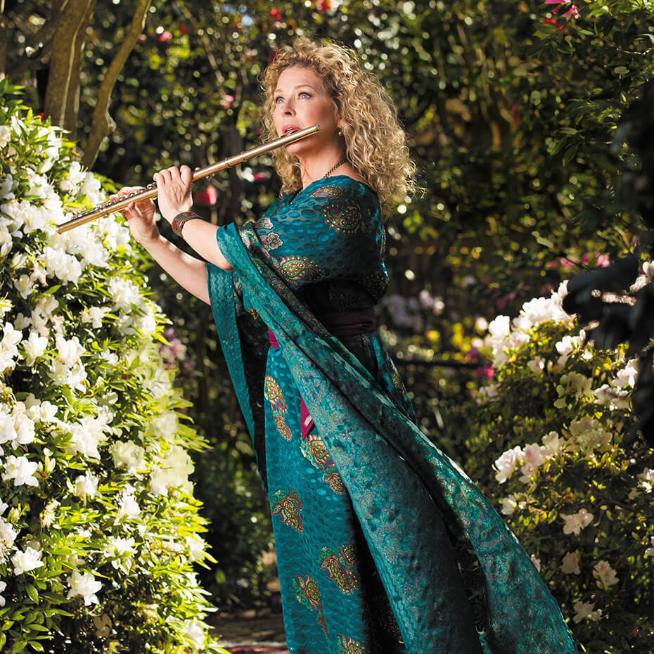 Jane Rutter playing flute in green dress