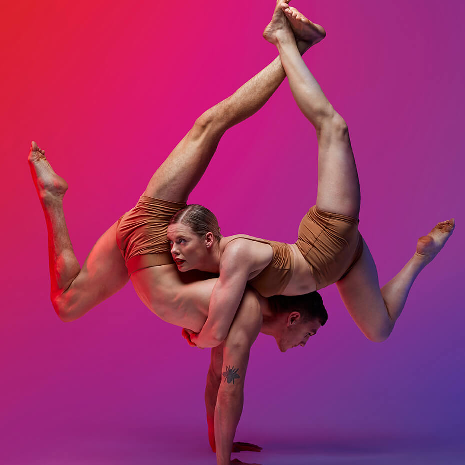 Two people in circus position