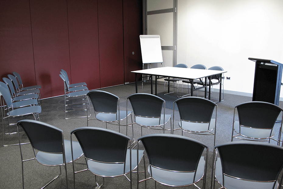 Meeting room set for presentation with chairs facing toward white board