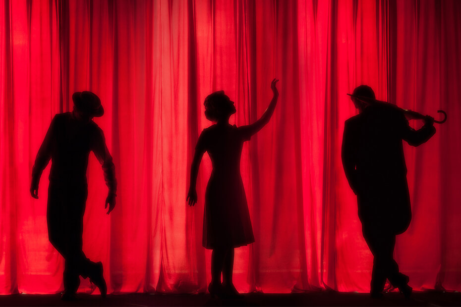 Silhouette of performers on stage