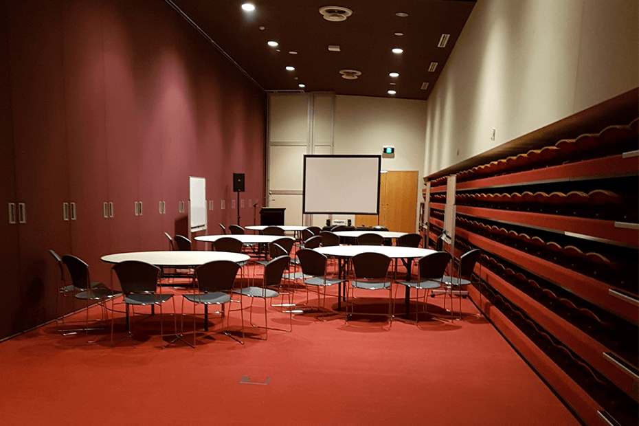 Mezzanine meeting room set up with round tables