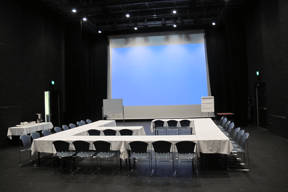 U shaped table setting for conference in Studio theatre