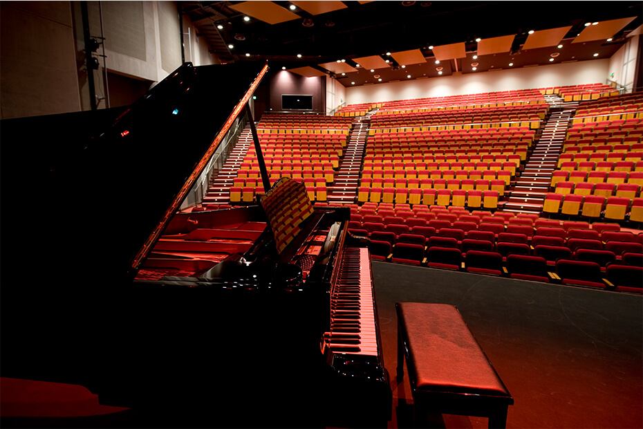 Piano in foreground looking out to large theatre