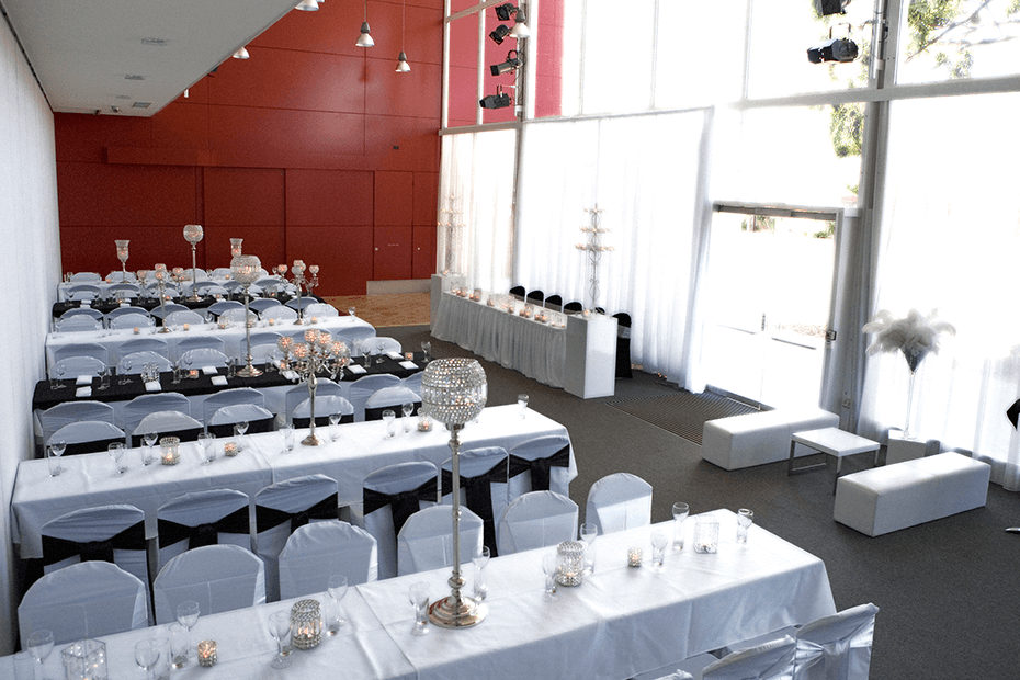 Long tables set for wedding in Gallery